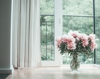 Free Glorious Pastel Pink Bouquet Of Peonies In Glass Jug On Floor By Window. Flowers In Interior Design. Stock Image - 105160641