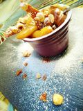 Glorious Salted Caramel, Hazelnut and Pear Dessert Pot. Dusted with Icing Sugar and presented on Slate Plate outdoors royalty free stock photography