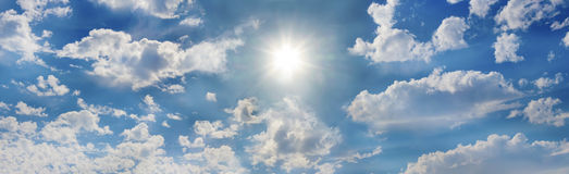 The glorious sun. Amazing dramatic cloudy sky panorama with sun shining in all its glory in the center royalty free stock images