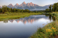 Glorious Sunrise in the Tetons. As the sun rise over the Gros Ventre range, the peaks of the Tetons in Grand Teton National Park, Wyoming are ablaze with a fiery Royalty Free Stock Photo