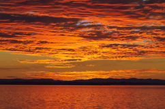 Glorious sunset. Glorious orange sunset over Moreton Bay, Queensland Australia. In the background, the Island of Stradbroke stock photography