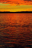Glorious sunset. Glorious orange sunset over Moreton Bay, Queensland Australia. In the background, the Island of North Stradbroke stock images
