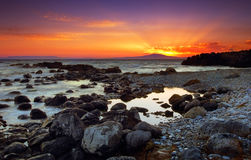 Glorious sunset over rocks Stock Photography