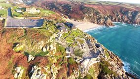 Glorious waterfall at Porthcurno beach, Cornwall looking up into deep blue sky stock video