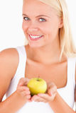 Glorious woman holding an apple Royalty Free Stock Photography