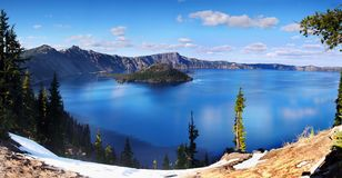 Crater Lake National Park, Oregon United States. The gloriously crystal blue waters in Crater Lake, National Park, Oregon. Crater Lake is the deepest lake in the Stock Photos