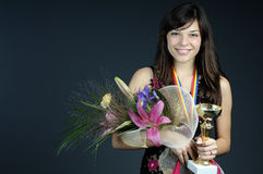 Glorius teen holding prize Royalty Free Stock Photo