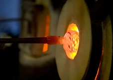 Glory hole. Heating glass in glass blowing studio royalty free stock image