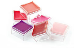 Gloss boxes. On white, lips makeup Stock Photo