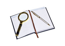 Gloss magnifier with a silver pen. Stock Images