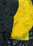 Gloss yellow and black fabric texture. Grunge style fragment for creative design ideas royalty free stock photography