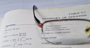 Glossary of the notations on a school and university textbook Stock Photography