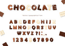 Glossy ABC letters and numbers, made of different kinds of chocolate - dark, milk and white. Sweet font design. Royalty Free Stock Photos