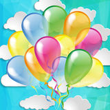 Glossy balloons on a sky background. Multicolored glossy balloons on a sky background Royalty Free Stock Photos