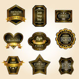 Glossy black gold vintage and retro badges design  Stock Images