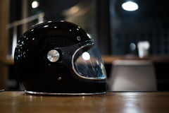 Glossy black helmet on table Royalty Free Stock Photos