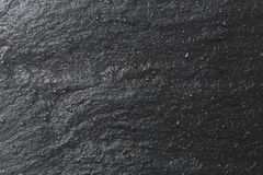 Glossy black slate background or texture Stock Images