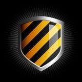 Glossy black and yellow shield emblem Royalty Free Stock Photo