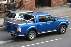Glossy blue Ford Limited pick-up Royalty Free Stock Images