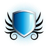 Glossy blue shield emblem. With floral vine accents Stock Images