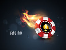 Glossy chip in flame for casino concept. Royalty Free Stock Photos
