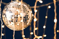 Glossy disco ball with garland. On black background stock photography