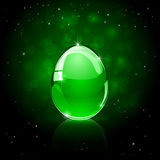 Glossy Easter egg on green background Stock Photo