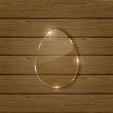 Glossy easter egg on wooden background Stock Image
