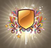 Glossy escutcheon decorated with floral elements Stock Photos