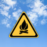 Glossy Fire danger sign. On beautiful sky background Stock Photos