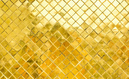 Glossy Gold mosaic tile wall, texture background Royalty Free Stock Photo