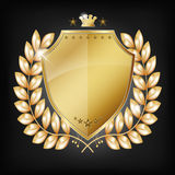 Glossy golden shield with laurel Royalty Free Stock Images