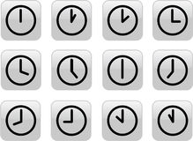 Glossy gray clocks. A clock for every hour Royalty Free Stock Photography