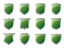 Glossy Green Shields. A set of glossy shield icons (available as vector Royalty Free Stock Photos