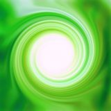 Glossy Green Swirl. Glossy and shiny yellow green swirly swirl radial design with round white center. Background, backdrop, and or liquid creamy texture Royalty Free Stock Images