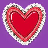 Glossy heart with lace edging. Stock Image