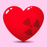 Glossy heart with radioactive symbol Royalty Free Stock Images
