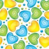 Glossy hearts. Seamless pattern with blue, green and yellow glossy hearts Stock Images