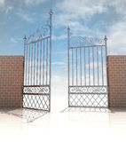 Glossy iron gate in strong brick wall concept Stock Photos