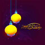 Glossy Lamps with Arabic text for Ramadan Kareem. Glossy hanging Lamps with Golden Arabic Islamic Calligraphy of text Ramadan Kareem on shiny background Royalty Free Stock Photos