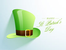 Glossy leprechaun hat for Happy St. Patricks Day. Happy St. Patricks Day celebration with glossy leprechaun hat on blue background Stock Image