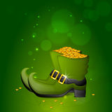 Glossy leprechaun shoes with coins for St. Patricks Day. Royalty Free Stock Photo