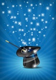 Glossy magic hat and wand in action Stock Image
