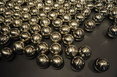 Glossy Metal Ball. On the dark background Stock Image