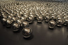 Glossy Metal Ball. On the dark background royalty free stock photography