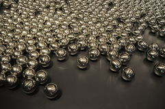 Glossy Metal Ball. On the dark background stock images