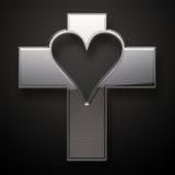 Glossy metal Jesus Cross heart shape. On grey background Stock Photos