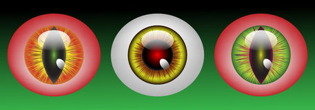 Glossy monster eyeballs. In three colors on green background Stock Photography