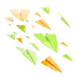 Glossy orange and green paper airplanes isolated Royalty Free Stock Images