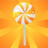 Glossy orange lollipop background Stock Photography